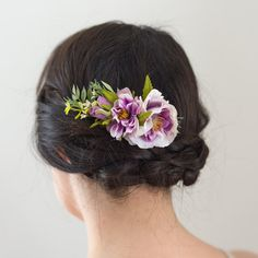 A beautiful purple coloured comb, perfect for bridesmaids or a pop of colour in a bridal updo. Created with fine silk flowers and greenery accents, the flowers are wired onto a gold comb. Dimensions: Length of floral elements: 5, Length of comb: 2.5  This is a one of a kind headpiece hand crafted with the finest materials in our Halifax, Nova Scotia studio. Oh Dina! millinery has been featured in Style Me Pretty, Weddingbells Magazine, Flare Magazine, and the National Post, just to name a…