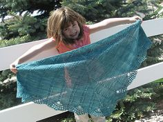 As a shawl, Tiare is triangular and worked from the top center out to the lacy edge. As a scarf, it is worked from the center out, from a provisional cast on. Both feature a simple eyelet mock cable that is quick and simple, with the beautiful corona lace scalloped edge. Options are given for both a crocheted and knitted bind off. Instructions are written and charted.