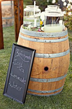 wine barrel used to hold beverage containers