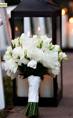 All white simplicity! Beautiful for ANY wedding! (roses, calla lilly, fressia)