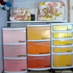 My Colorful {ombre} Basement Craft Storage ~ Madigan Made { simple DIY ideas } She decopaged paper to the inside of the clear drawer front to add color to her plastic drawer organizers. Neat idea.
