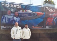 Local celebs? Team Pickfords pose with their banner at Greenock.