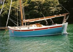 A 20' LOD, blue water capable, traditional looking sailboat - 20ft Falmouth working boat.  Percy Dalton did plans for a cabin version, similar to the boats from Heards Yard.