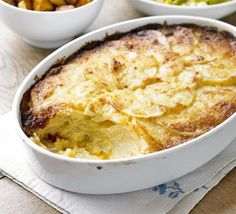 Dauphinoise potatoes. Thin slices of potato slow-cooked in the oven with cream and garlic- the most decadent of side dishes