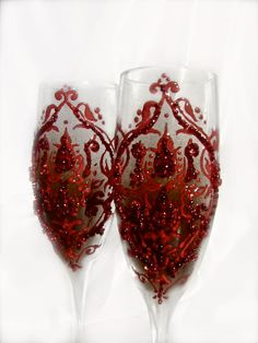 Wedding champagne glasses, toasting flutes with a blood-red damask on a chocolate background. $54.00, via Etsy.
