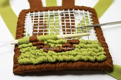 Locker hooking tutorial - a neat way to make durable rugs from scrap fabric strips, t-yarn, or even unspun roving