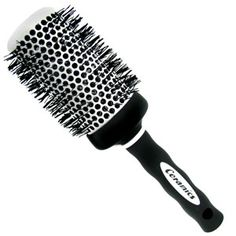 Every girl needs a round brush like this, its metal so it will pick up the heat of your hair dryer and curl your hair for you, just make sure your hair is 90 percent dry when you start so that you'll be able to get some shape without killing your arm!