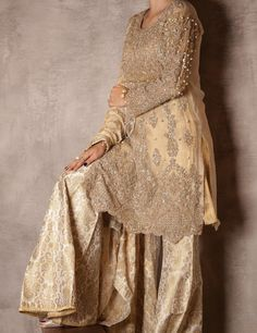 Ravishing embroidered golden stitched 3 piece dress by Almirah formal collection 2018