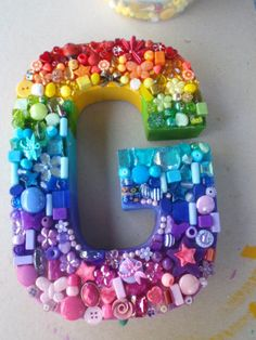 For the girls. Have your toddler pick out small toys and such of the different colors of the rainbow to put on the letter of thier name.