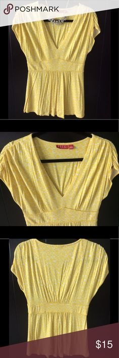 ELLE yellow and white dressy top ELLE yellow and white dressy top. Gently used and clean condition. No holes or stains. Material: 96% rayon and 4% spandex material. Smoke free and pet free home Elle Tops Blouses