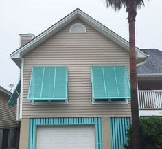 Bahama shutters give this home a cottage look.  From drab to fab in a day!  Why wait?  We offer 0% Financing! #curbappeal #bahamashutters #thelouvershop