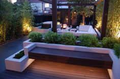 Floating bench with rendered planters & lighting - too much planting but nice use of shapes.