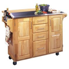 This charming kitchen cart with breakfast bar is constructed of solid hardwoods in a natural finish. Features include two storage cabinets with raised panel doors, four storage drawers on metal glides, a spice rack, towel bar and caster wheels.