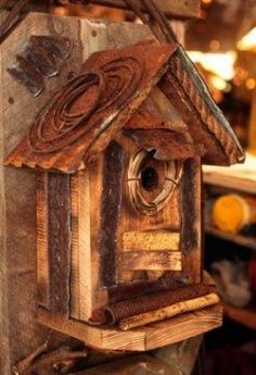 old wood, tin roof, and barbed wire bird house idea