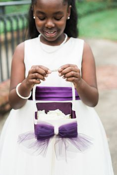 Purple flower girl idea - white a-line dress with purple ribbon and white petal basket with purple bow {MyLife Photography}