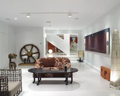 Contemporary Home in White with Artistic Interior Decoration : Bright Beylerian House Living Room Decorated With Wicker Armchair Mobile Coff...