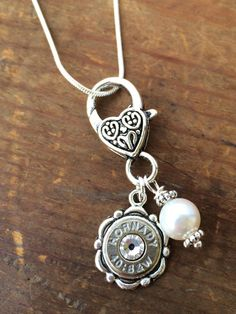 Bullet Charm  Bullet Jewelry  Silver Bullet by RicochetRounds, $19.95