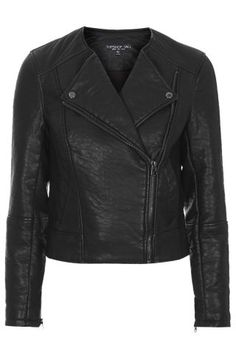 You don't have to have an edgy style to wear Moto Jackets. Topshop jacket: