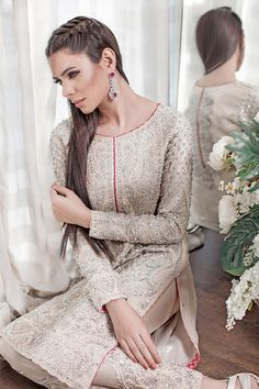 Sheer elegance reigns this latest A/W'15 evening wear capsule by Sana Abbas. Contemporary classics perfect for wedding season are heavily crafted with hand work that is rich yet intricate eno…