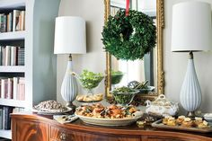 Decorate with Family Heirlooms - 100 Fresh Christmas Decorating Ideas - Southernliving. Use heirlooms in your Christmas decorating. Don't forsake your sentimental hand-me-downs. Instead, showcase them by putting them on display: This mahogany buffet fits perfectly into a niche built just for it. Update the pieces with modern accessories, such as a pair of mod white lamps, which help a traditional piece of furniture blend seamlessly with more modern tastes.