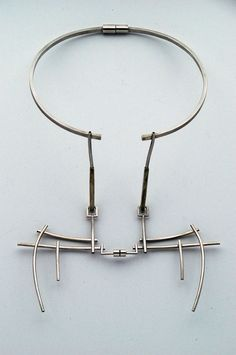Necklace | AKA Jewellery.  Silver, white amber, magnets.  Worn on the back