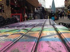 Coloured table in Camden market, London