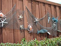 Would love to decorate the fence by the pool with a fish/ocean theme.  Fun!