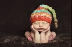 Super uncomfortable pose, but  awesome hat/ baby :3