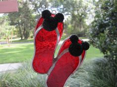 These flipflops are made of red rough rolled glass and have a pair of glittery black mouse ears on the straps.They are approx. and hang by monofilament.They are finished in lead-free came and solder.Thanks for visiting WindwoodGlass! Disney Garden, Mickey Mouse Kitchen, Disney Home Decor, Mouse Ears, Suncatchers, Flip Flops, Bling, Red, Spaces