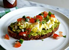 A delightful way to start your Meatless Monday morning, these scrambled eggs and pico de gallo avocado toast are hearty and filled with flavor. I didn't add cheese but these are my Favorite breakfast