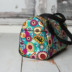 """A stunning, rockabilly-inspired bag in three different sizes, 10.5"""", 12"""" and 14"""" wide. Large side slip pockets, a zippered lining compartment, and a removeable crossbody strap make it as functional as it is stylish. You'll want to make a Blanche for everybody you know."""