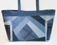 This medium size tote bag, handbag or purse constructed from upcycled denim jeans and repurposed cotton fabric is a perfect size to comfortably carry your daily essentials, magazines or books and miscellaneous items. The unique exterior front and back feature a 2 top border and pockets pieced together with diagonal denim strips. The front exterior pocket measurments are approximately 9 x 7 1/4, the back pocket 5 1/4 x 5 1/2, perfect size for your cell phone and miscellaneous it...