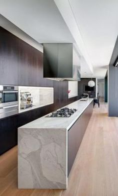 HUGE # minimalistic kitchen cleanlines amazing marble waterfall countertop it may appear to you to be cold however it's just an amazing space no hoarders here!