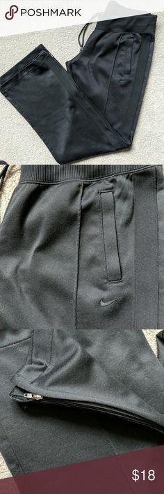 Nike sweatpants Nice pair of my Nike sweatpants. Has pockets, elastic waistband with drawstring, zipper hem at the ankles. Size medium Nike Pants