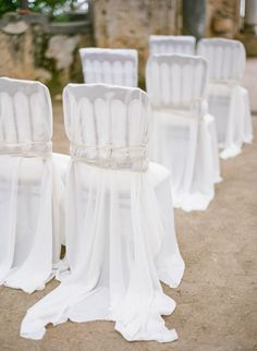 Dramatically draped: http://www.stylemepretty.com/2015/09/07/all-white-wedding-details-we-love/