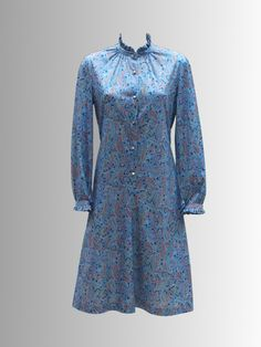 1970s Blue Paisley Dress from www.sixesandsevensvintage.com at £22.00  Size 12-14.   The paisley print uses light blues, pinks and turquoise to give a delicate pastel coloured detail. This added to the frill around the collar and sleeves really makes for a pretty item.   The dress is in good vintage condition but the metal buttons are slightly tarnished, in line with the age of the dress. Retro Vintage Dresses, Retro Dress, Paisley Dress, Paisley Print, Metal Buttons, No Frills, Dresses For Sale, 1970s, Blues
