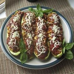 Zucchini shells are filled with a rice and minced lamb stuffing make a satisfying yet healthy meal. I Love Food, Good Food, Yummy Food, Baked Stuffed Zucchini, My Favorite Food, Favorite Recipes, Cooking Recipes, Healthy Recipes, Paleo Ideas