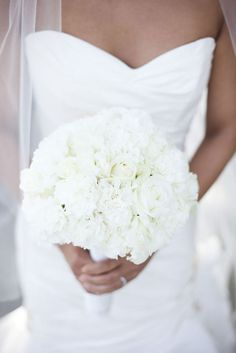 This is actually a white rose and carnation bouquet!  Photography: Luna Photo - lunaphoto.com/  Read More: http://www.stylemepretty.com/california-weddings/southern-california/2011/08/04/the-forster-mansion-wedding-by-luna-photo/