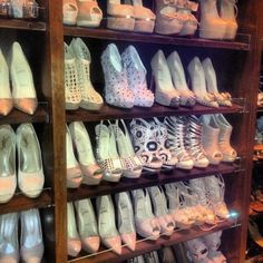 Kim Kardashian's shoe closet.  Just another reason to hate her sans guilt.  I'll take the studded bow platforms on the middle shelf, please (if I have to choose just one pair).