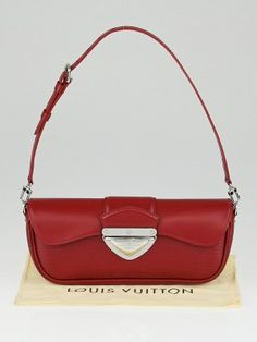 This Louis Vuitton Rubis Epi Leather Montaigne Clutch Bag is one exquisite piece. Its chunky shiny hardware and beautiful textured leather makes it eye-catching. Looks aside, this bag is so versatile with three different looks. It has an adjustable and removable strap that allows you wear it on the shoulder, as a wristlet or carry it clutch-style. Retail price is $1100.  The Louis Vuitton Epi Leather collection was first introduced in 1985 and was created to respond to the demand for more…