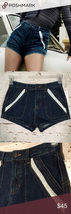 """Free People Mini Dark Wash Denim Jean Shorts Sweet denim high rise shorts featuring slanted side pockets with eyelet trim and back slip pockets. Button closure and zip fly. Best for a very slender body type.  Approximate Measurements: (all measurements are taken across, laying flat and unstretched)  Waist: 13.5"""" Inseam: 2"""" Rise: 10.5"""" Leg Opening: 10"""" Free People Shorts Jean Shorts"""