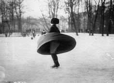 A Woman's Skirt billows out as she pirouettes on a Frozen Lake in a Park in Berlin • 1914