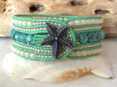 Hey, I found this really awesome Etsy listing at https://www.etsy.com/listing/228737532/key-west-style-5-row-beaded-leather-cuff