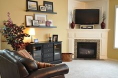 Living Room With Corner Fireplace really like the staircase coming down into the living room with