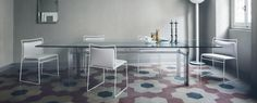 DOGE Table by Carlo Scarpa and TULU LG Chairs by Kazuhide Takahama, both made in Italy by Cassina and available at Centro.
