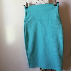 NEW Pencil skirt Color: turquoise size: small Fabric: 95% polyester & 5% spandex. Skirt is high waisted and able to wear with belt. Skirts Pencil
