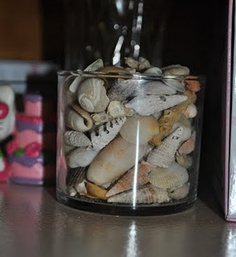 Recycling Candle Jars: love the idea of storing all our shells together and to keep dust free...
