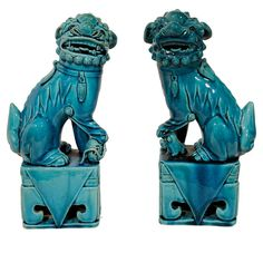 A Pair of Chinese Export Foo Dogs. Foo Dogs, often in pairs, resembling a cross between a lion and a dog, from Okinawan mythology. People place pairs of shisa on their rooftops or flanking the gates to their houses. Shisa are wards, believed to protect from some evils. When in pairs, the left shisa traditionally has a closed mouth, the right one an open mouth. The open mouth wards off evil spirits, and the closed mouth to keeps good spirits in.