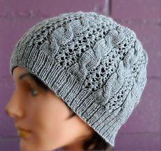 This slouch-style hat features alternating bands of eyelets and 3 x 3 cable. It is knit on needles slightly larger than is typical for the yarn to allow for more drape and wearability. See the matching Cables 'n Lace Cowl and Cables 'n Lace Mitts for the whole ensemble.