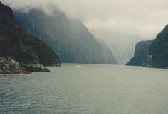 Milford Sound is a fiord in the south west of New Zealand's South Island, within Fiordland National Park, Piopiotahi Marine Reserve, and the Te Wahipounamu World Heritage site. With a mean annual rainfall of 6,813 mm on 182 days a year, a high level even for the West Coast, Milford Sound is known as the wettest inhabited place in New Zealand and one of the wettest in the world. Rainfall can reach 250 mm during a span of 24 hours.